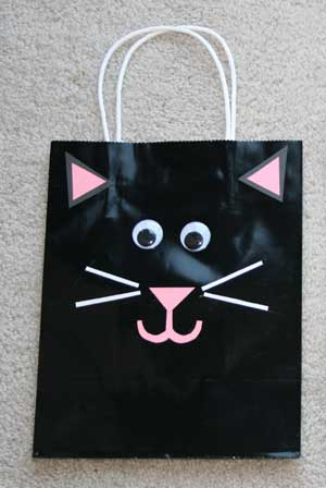 black cat trick or treat bag