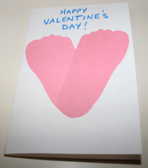 valentine holding heart footprint card craft